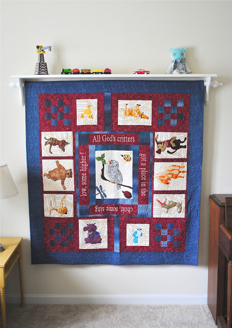 Diy how to hang a quilt the chronicles of home for Diy hanging picture display