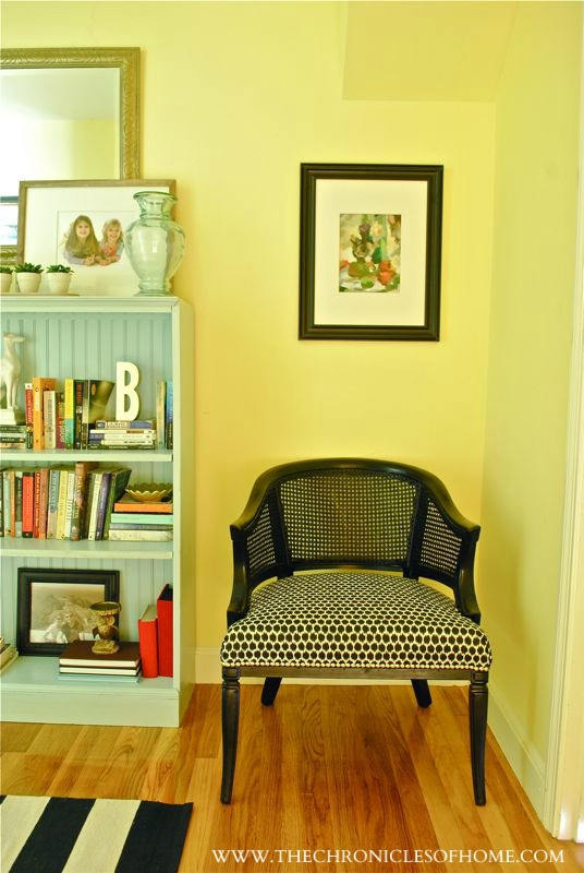 black and white chair with pale blue bookcase