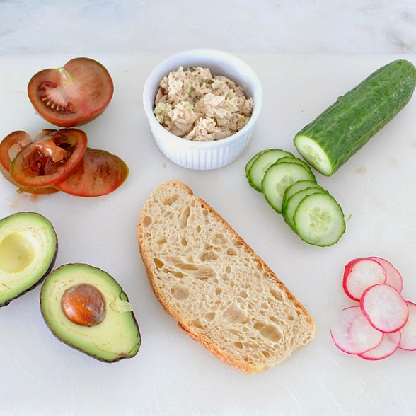 Easy and healthy lunch idea - tuna and avocado tartine sandwich with cucumber, tomato, radish, and dill