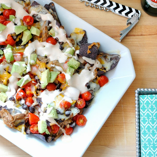 Ultimate pulled pork nachos with buttermilk hot sauce