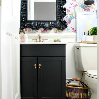 Powder room with Idira Damson peacock wallpaper, black, pink, gold, and purple accents