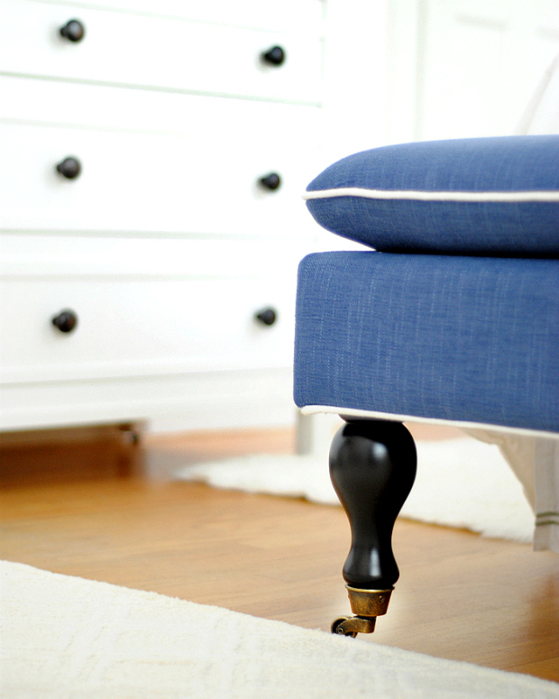 Navy blue bench with brass feet