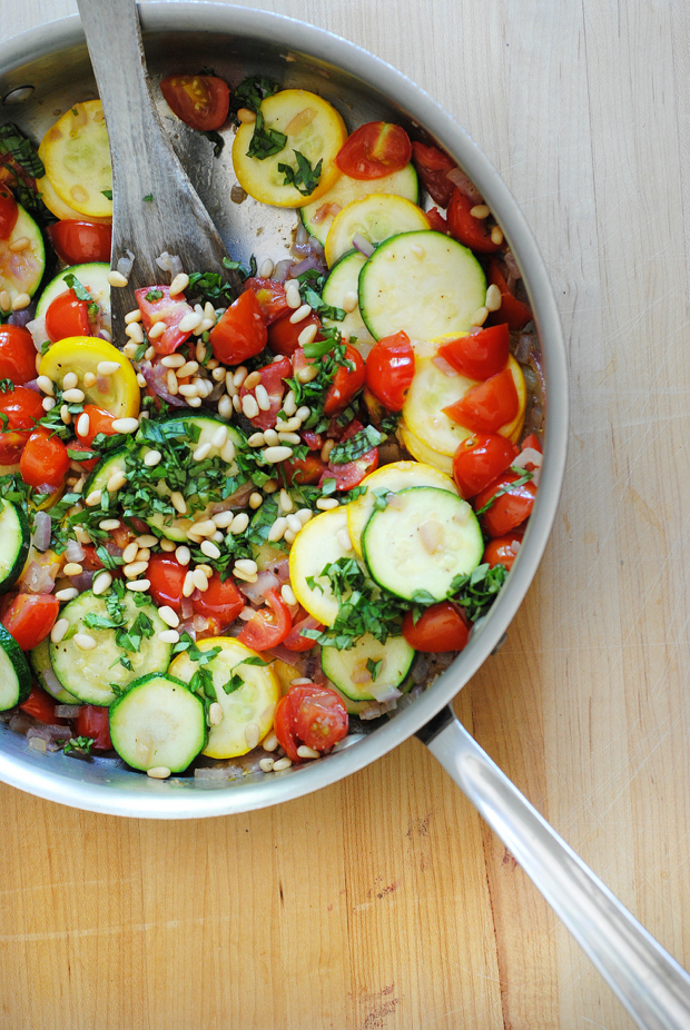 The most delicious, most simple use for all that summer zucchini! A quick sauté and some tomatoes, basil, and pine nuts make this zucchini recipe as irresistible as it is easy.