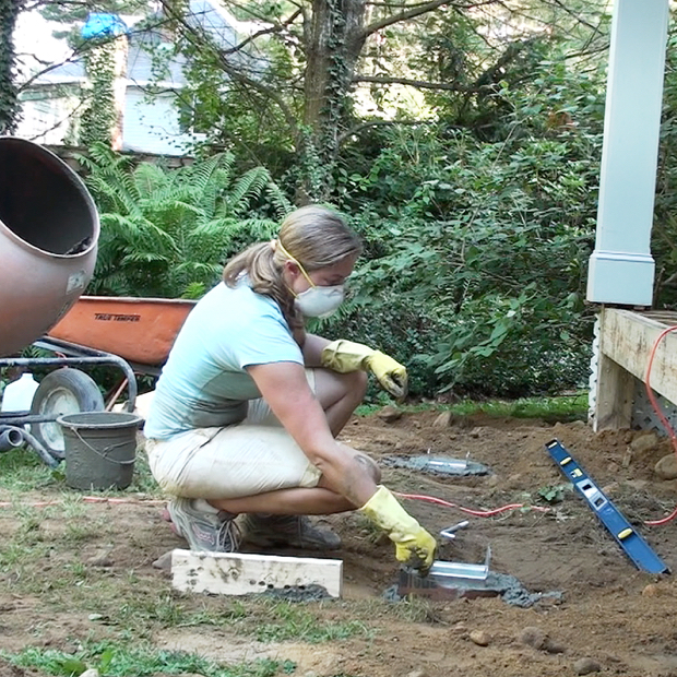 How to build a deck! This post has both video and text tutorials for the first step in building a DIY deck - digging and pouring the concrete footings.