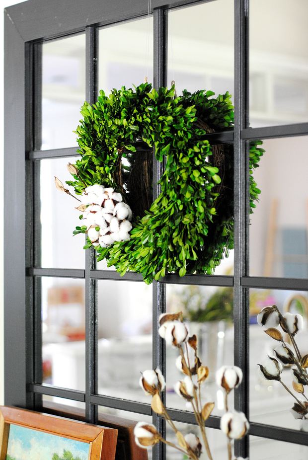 Easy fall decorating idea - preserved boxwood wreath hung on a mirror with a cluster of cotton clippings