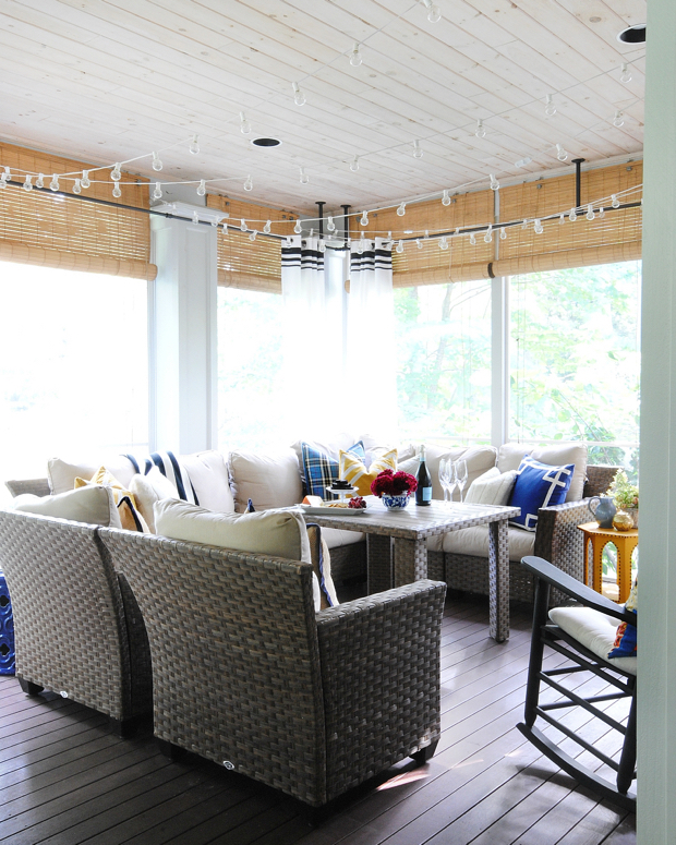 Fall porch with plaid, velvet, and faux fur in shades of blue and yellow