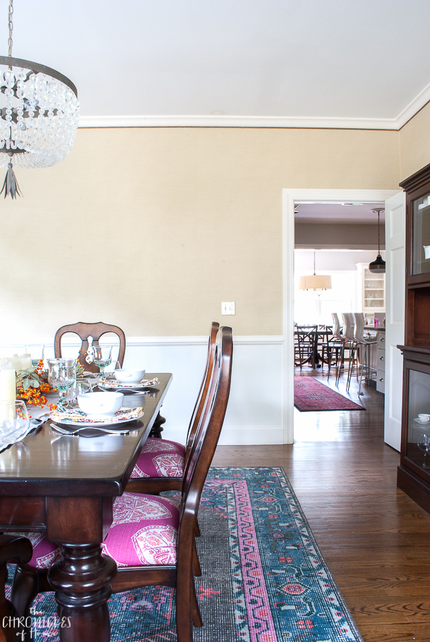 Beautiful dining room with a modern traditional feel - neutral with pops of pink and navy