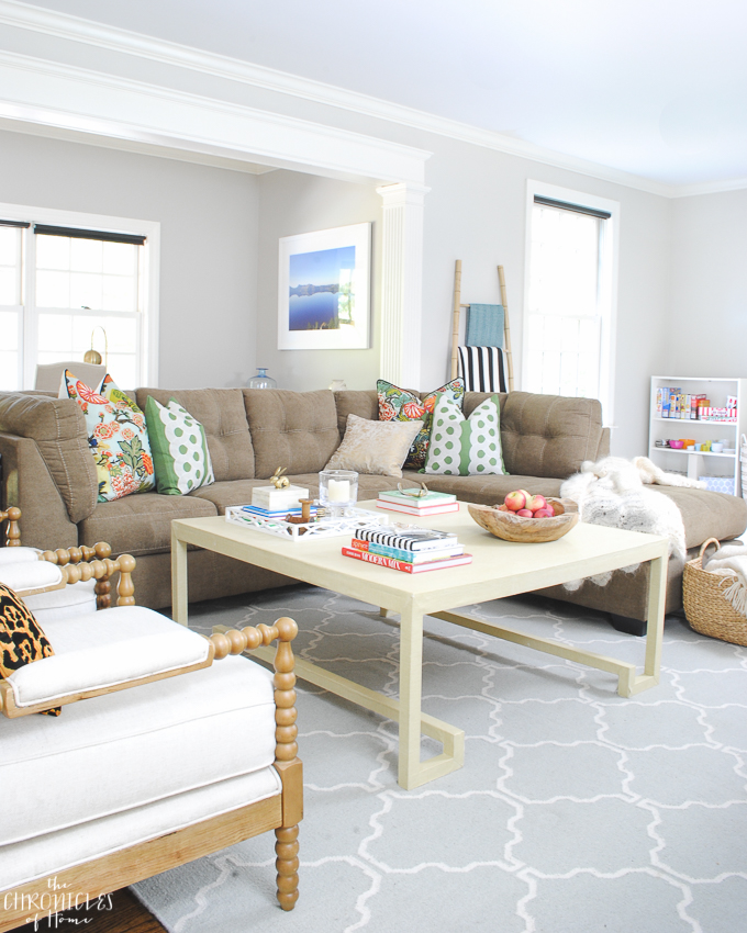 Budget family room makeover with neutral basics and pops of pattern and color - kelly green, Chiang Mai dragon, leopard
