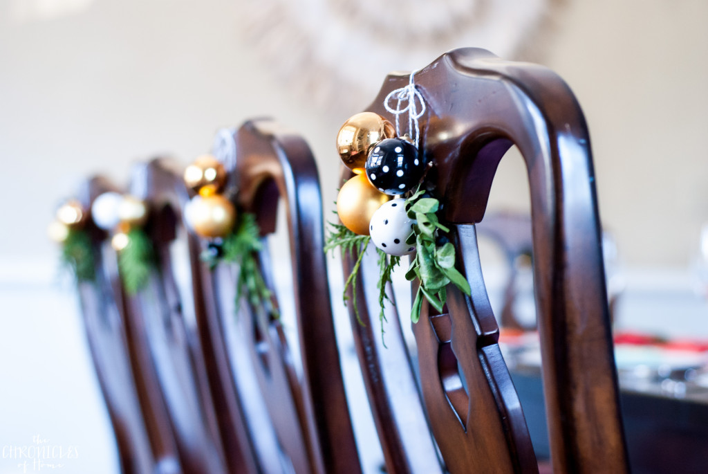 Easy idea for Christmas - hang a mini cluster and some greenery clippings on dining chairs for a pretty and festive look!