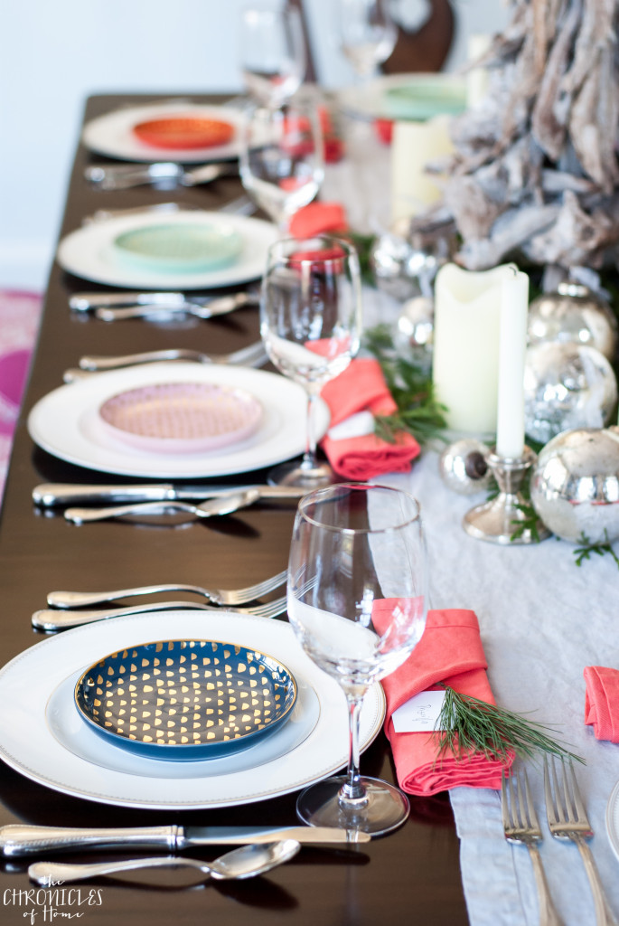 Beautiful Christmas tablescape featuring mercury glass, neutrals, and some pops of coral, navy blue, blush, and mint. Festive and classic but a little unexpected too!