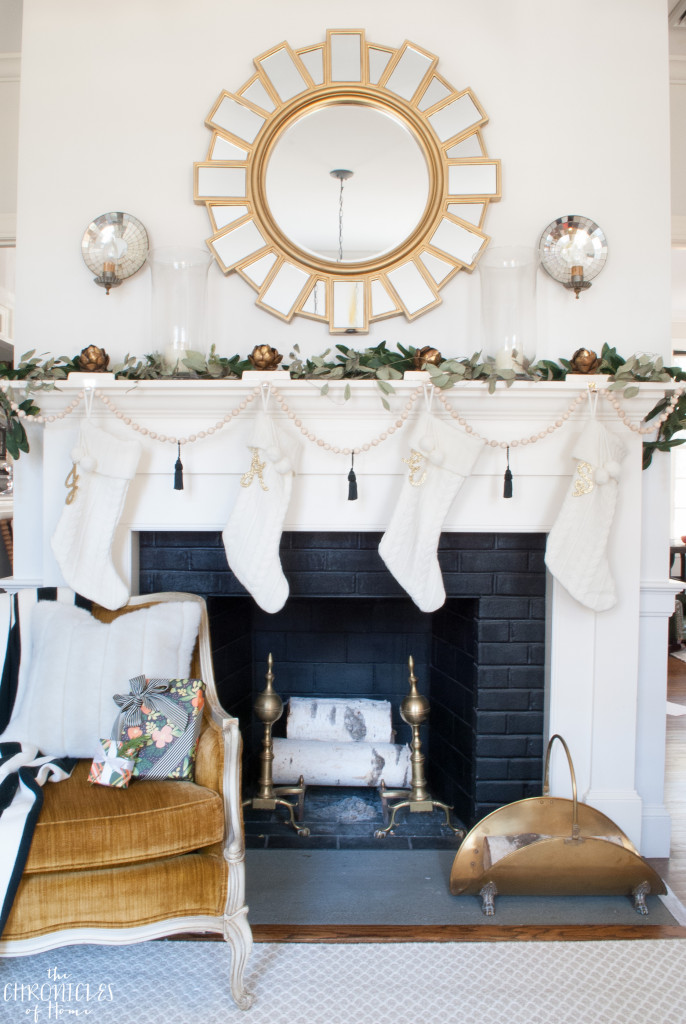 Soft, neutral, glam Christmas mantle with white, gold, greenery, and an easy DIY wood bead garland