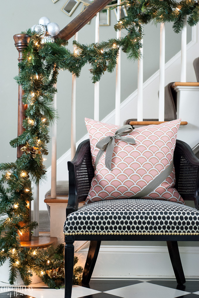 Fun and easy Christmas decorating idea - tie a ribbon around a throw pillow to make it look like a present!