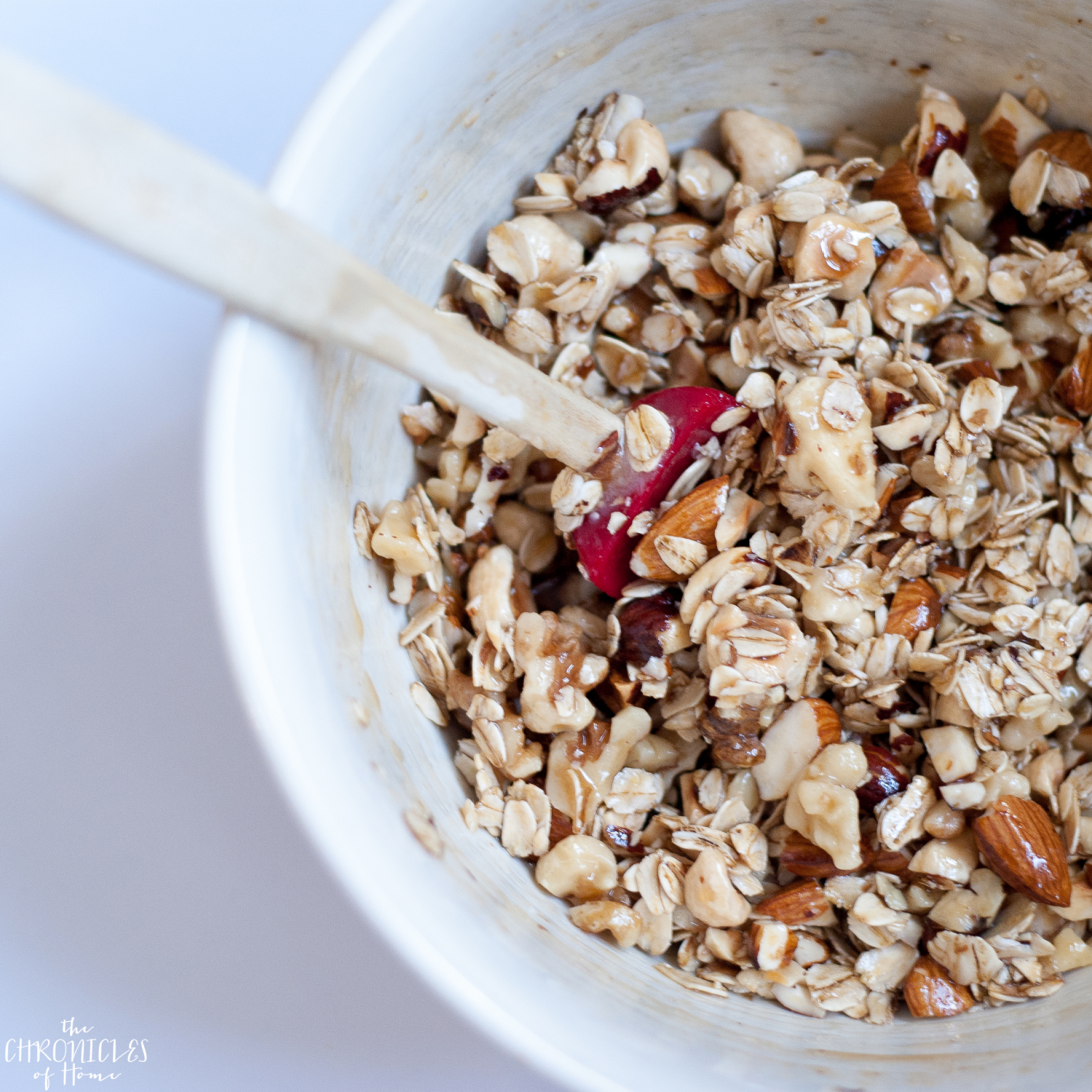 Oat and nut breakfast crumble - healthy, hearty, and delicious with nuts, seeds, fresh fruit, and an easy homemade cinnamon yogurt drizzle