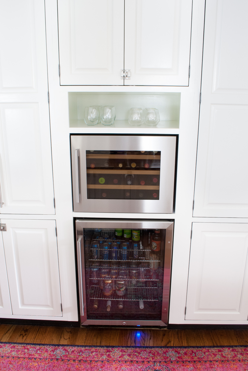 How to add a built in wine fridge and beverage fridge to existing cabinetry - it's simpler than you might think and adds great extra cold storage!