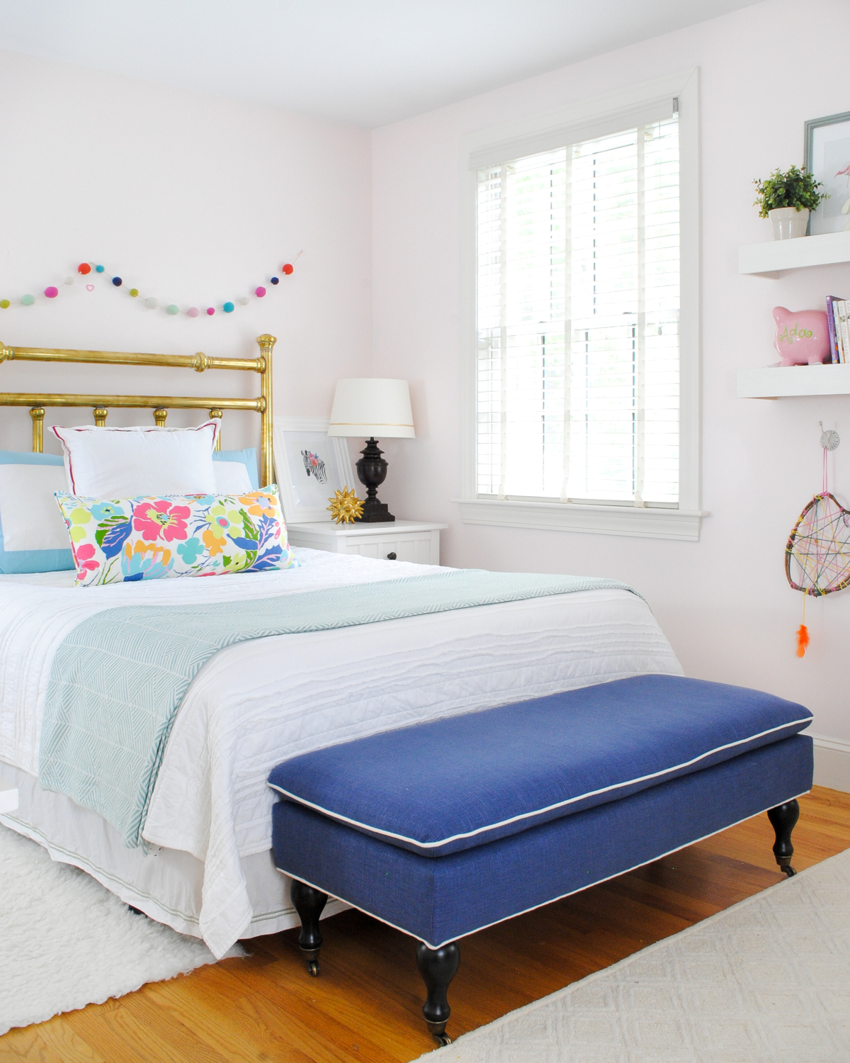 Beautiful neutral girl bedroom with navy blue, aqua, and pink accents - a bedroom to grow with a little girl.
