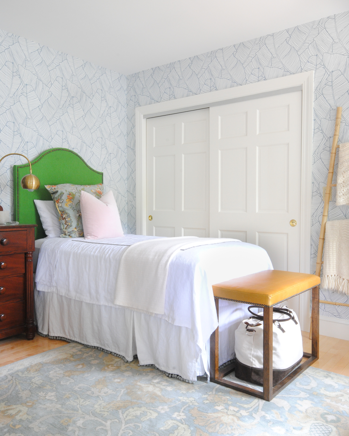 Beautiful bedroom with blue and white wallpaper, kelly green DIY upholstered headboards, blush pink, DIY leather bed benches. Such a stylish, happy, and serene space!