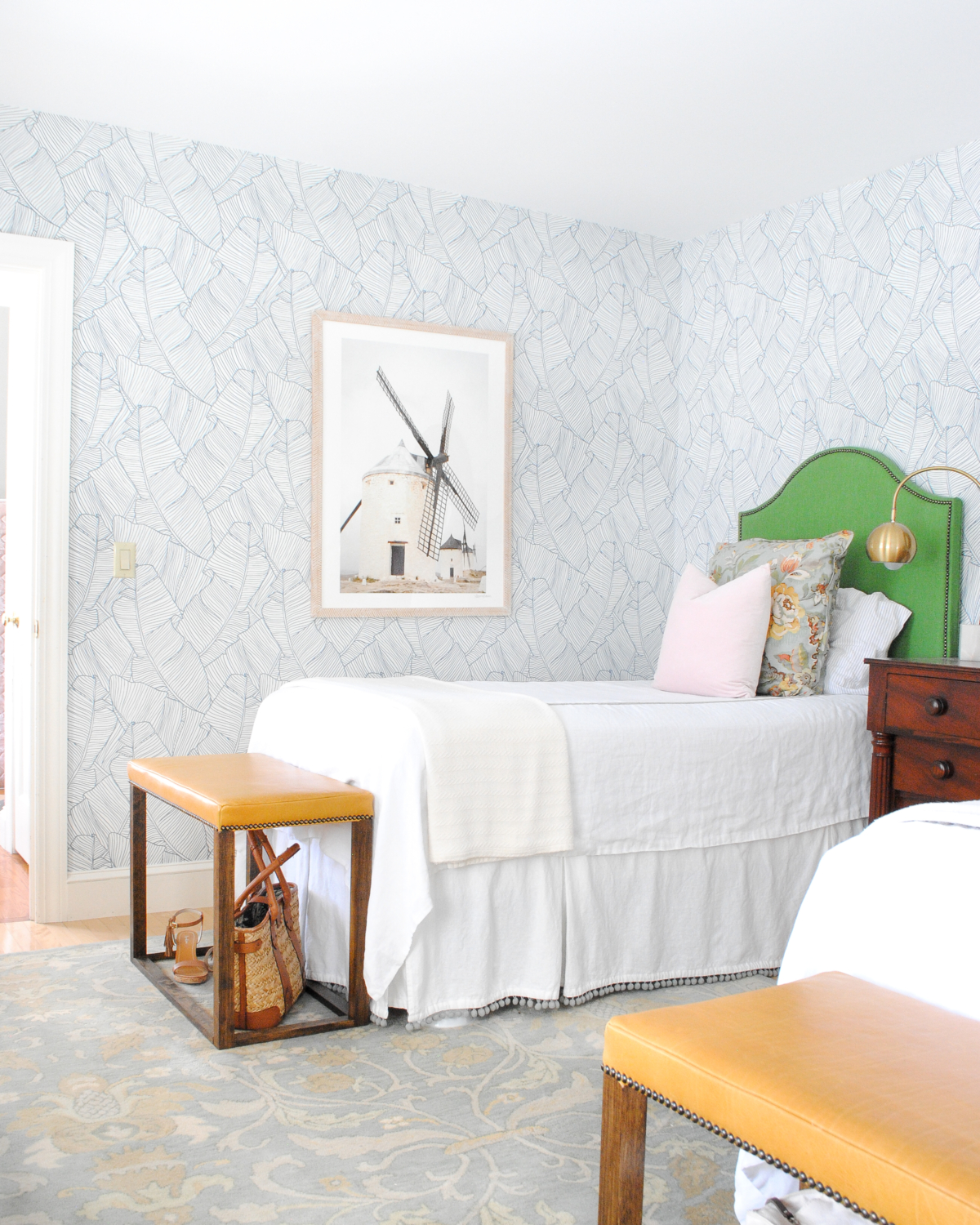 Beautiful classic, contemporary guest room with lots of DIY touches. Kelly green headboard, blue and white wallpaper, yellow leather bedroom bench.