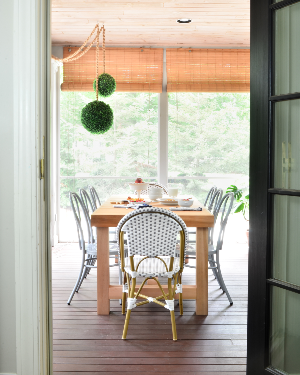 Metal bentwood chairs (that come in nine different colors!) and a DIY outdoor dining table inspired by a $4000 Restoration Hardware table are the perfect finishing touches to this totally gorgeous screened porch!
