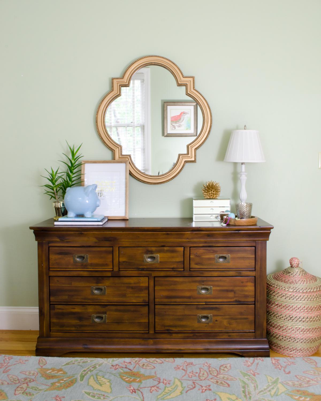 Hardwood dresser with campaign pulls (SUPER affordable) in a darling girl's bedroom