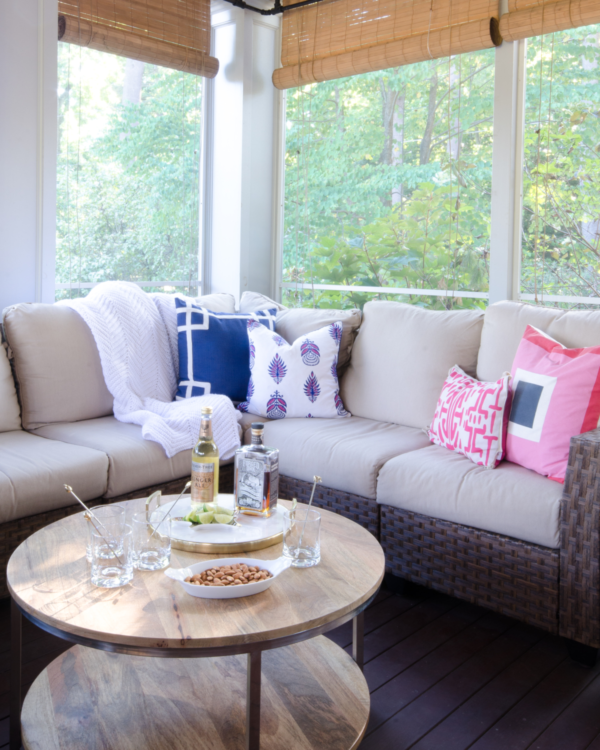 Stunning classic screened porch with pink, navy blue, and white.