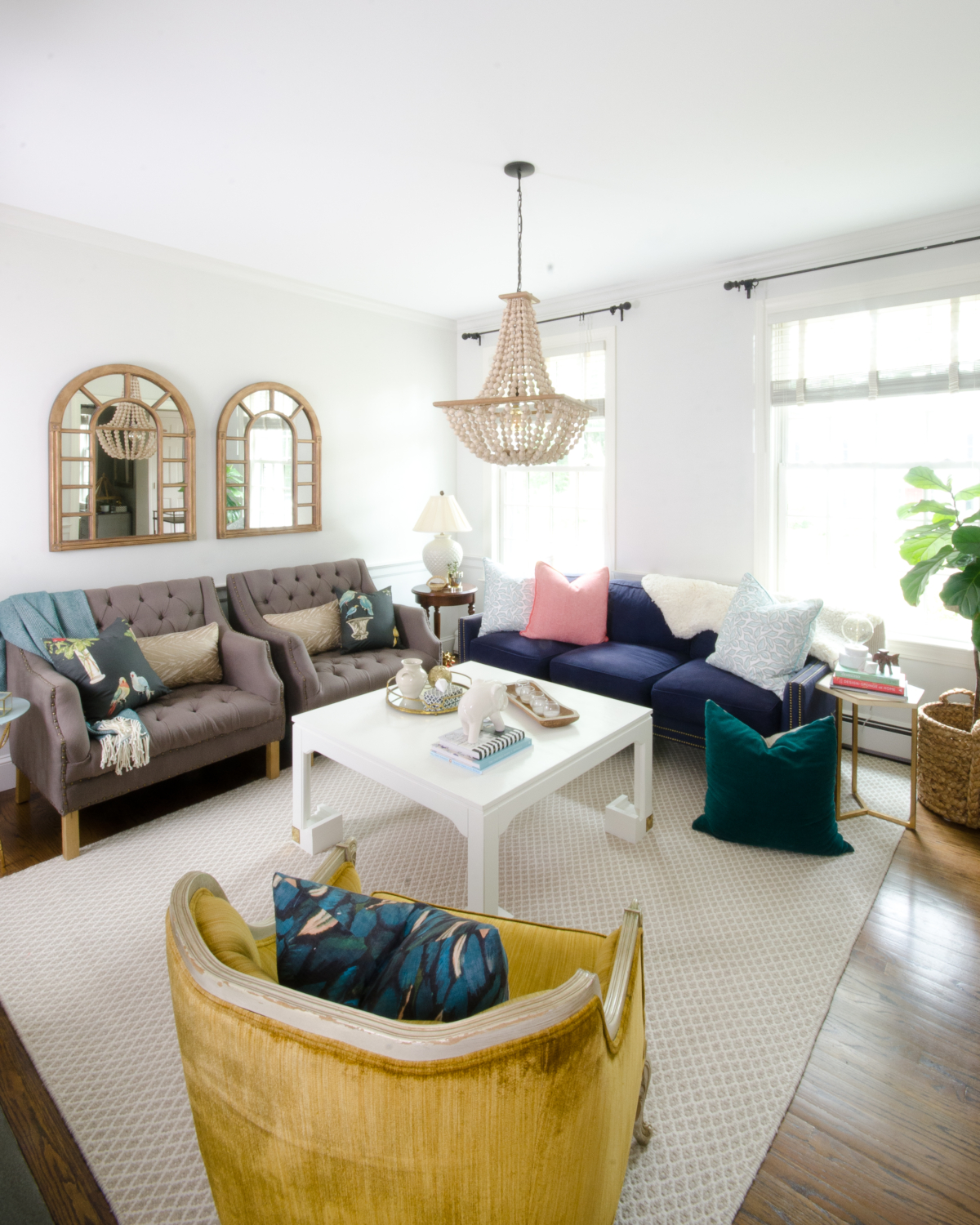Fresh classic fall living room with teal, yellow, and coral accents