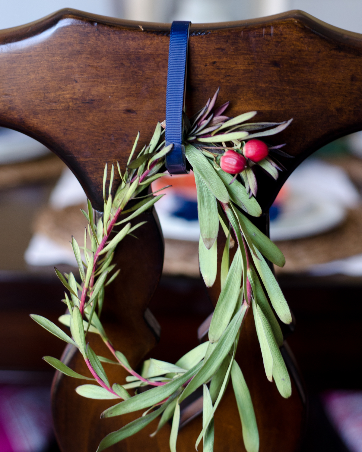 Easy Christmas decorating - miniature wreaths hung on the backs of dining room chairs