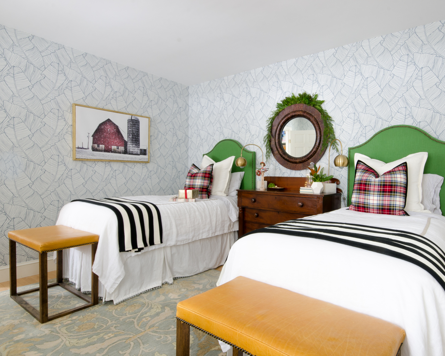 Classic Christmas guest room with custom DIY upholstered headboards, red plaid pillows, fresh greenery, and cute, quirky accents. Perfect way to make Christmas guest feel at home!
