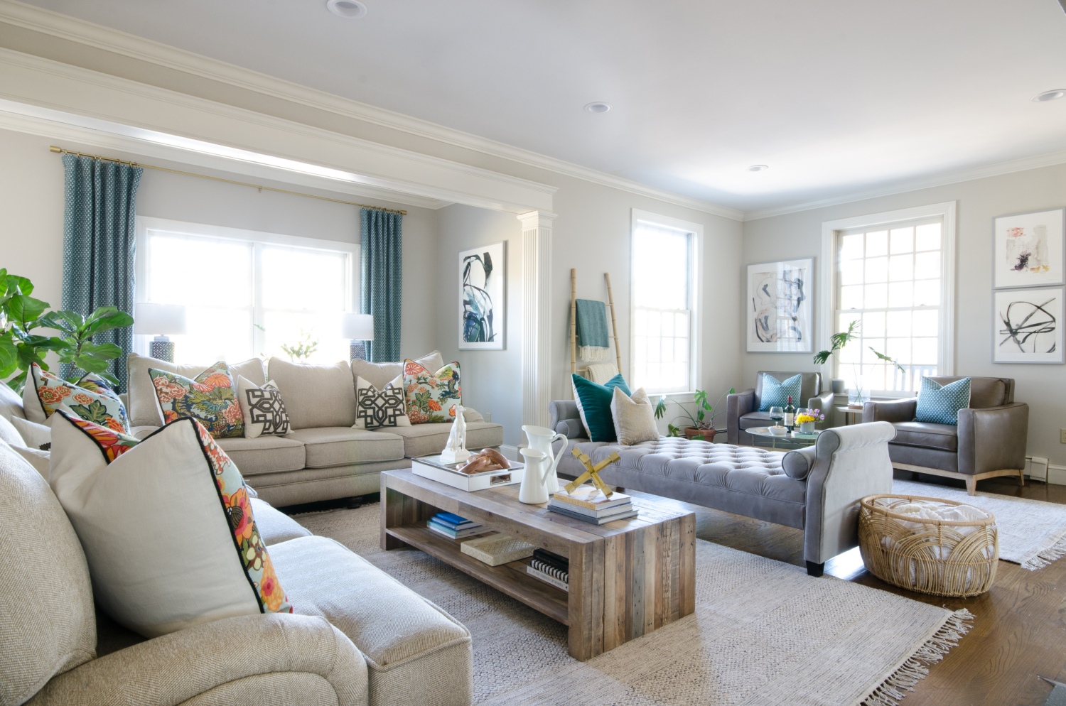 A family room makeover that is casual and chic with a neutral base and layers of teal and coral.