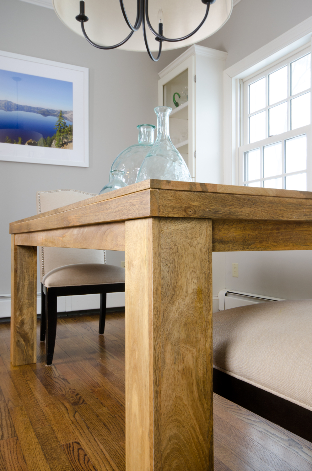 An affordable farmhouse table for under $350 with free shipping. See how it fits into plans for a stylish, family-friendly breakfast nook.
