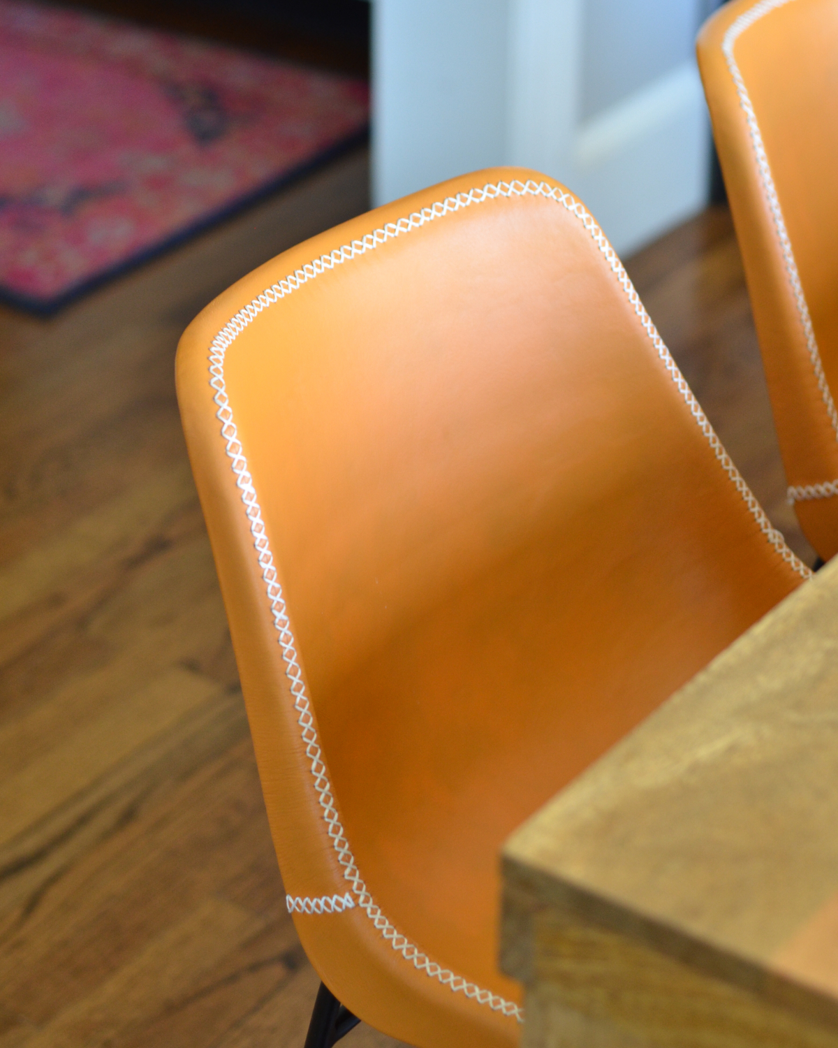 Leather side chairs in a breakfast nook makeover in process. Stylish, kid-friendly dining chairs can be hard to find but these small-scale beauties fit the bill!