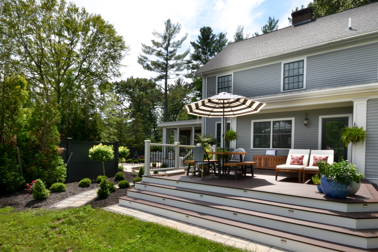 Stunning deck and patio featuring Trex Lava Rock and Techo Bloc pavers