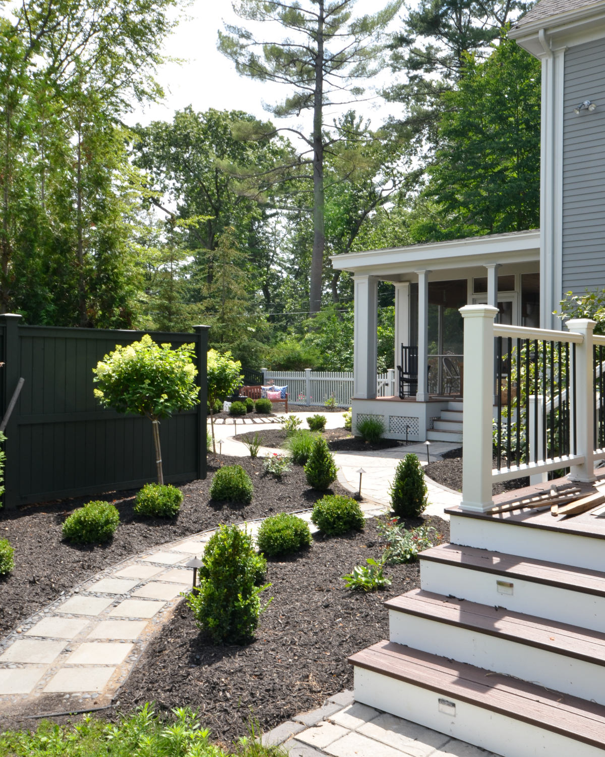Custom paver patio with a fountain at the center, classic outdoor living space ideas for decorating your deck or patio