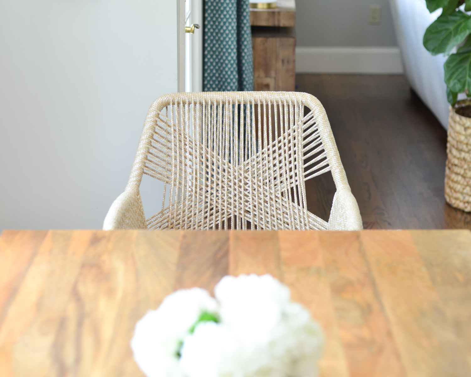 Beige rope chairs are a stunning addition to this chic yet family friendly breakfast nook makeover.