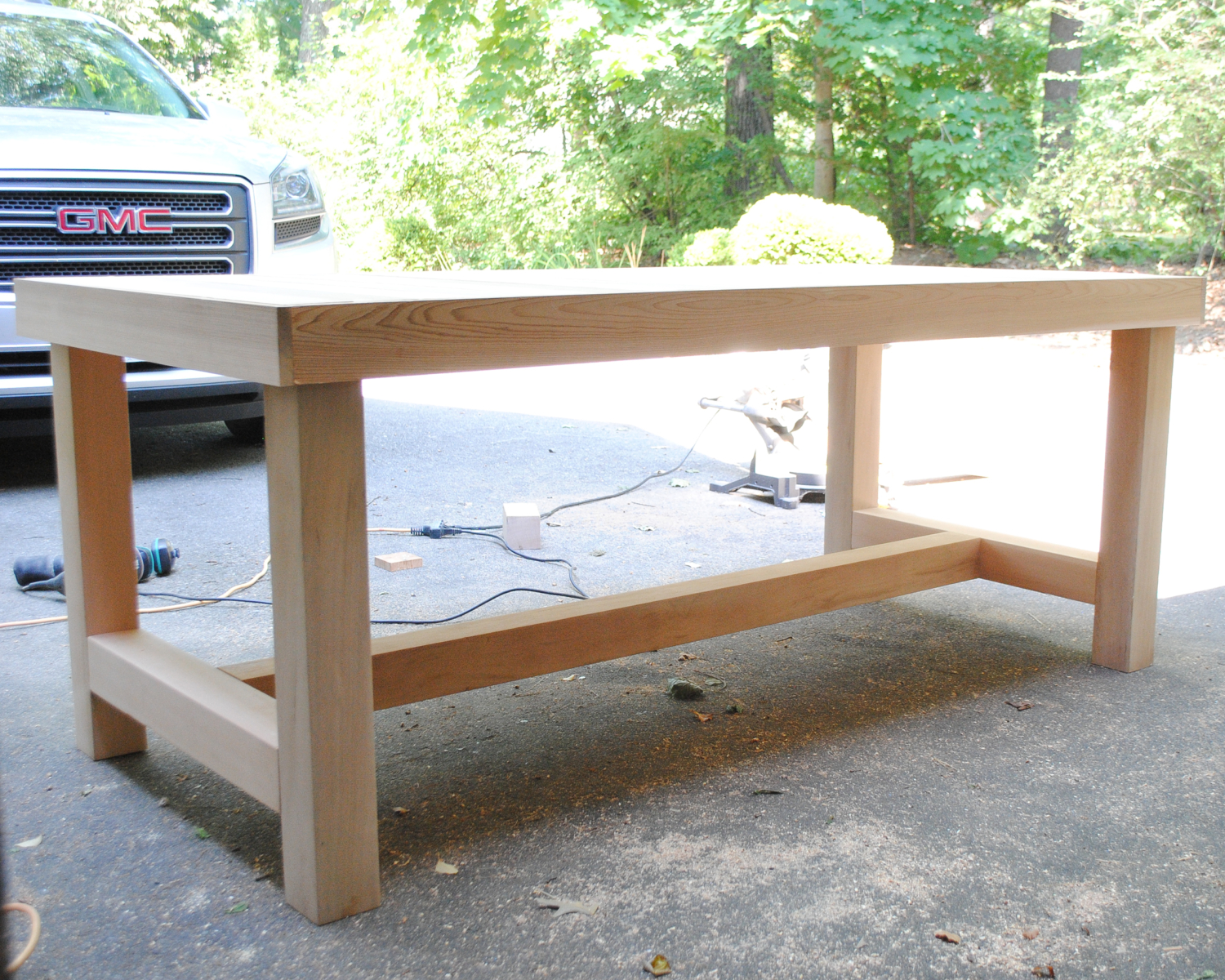 Free building plans for this DIY chunky farmhouse table. Modeled after a Restoration Hardware dining table but thousands of dollars less and really simple to build!