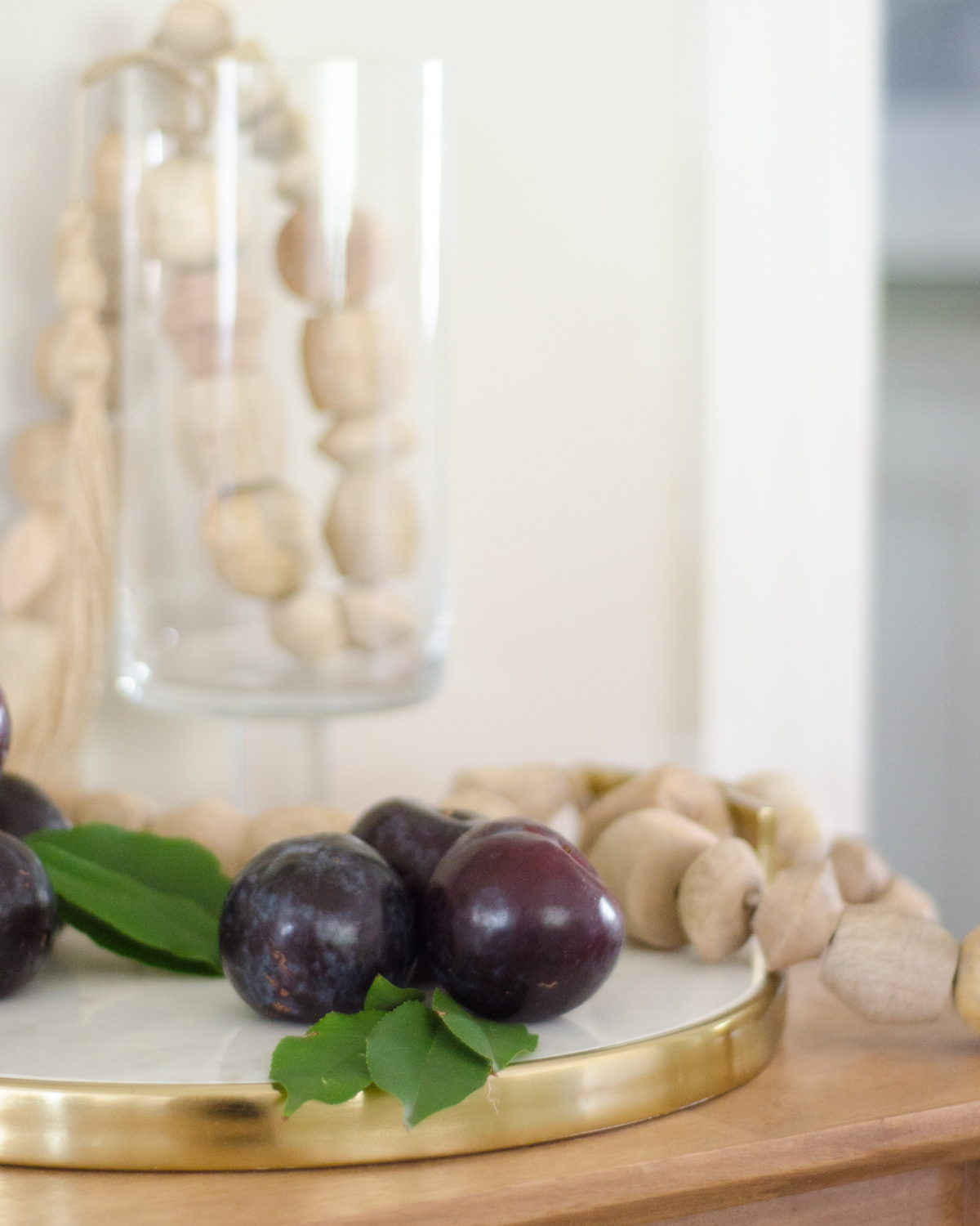 Simple fall decorating with fruit and a wood bead garland