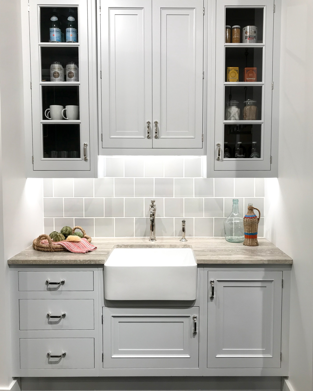 Pantry with grey cabinets, farmhouse sink, polished chrome hardware
