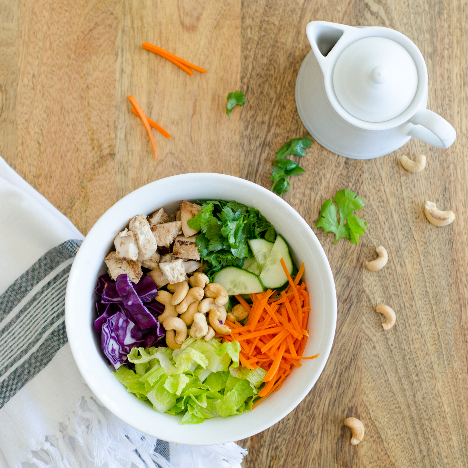 Thai chicken bowls - like thai lettuce wraps in a bowl! Loaded with veggies and topped with a nutty, creamy dressing. Paleo and Whole 30 recipe.