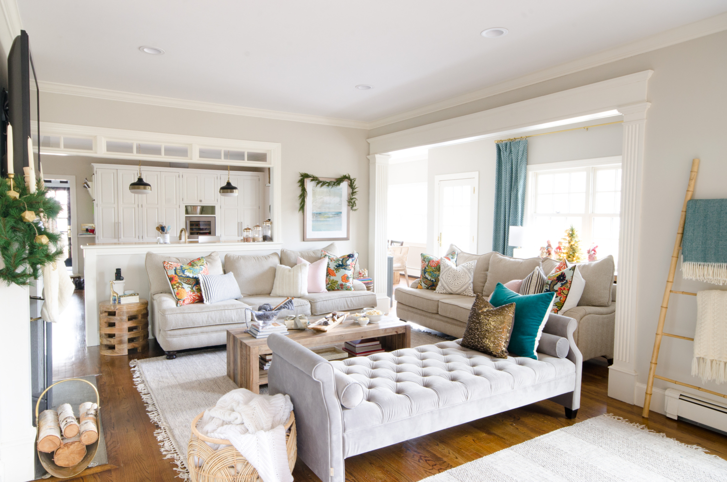 A simple and classic Christmas family room with greenery, white, and gold accents. 2017 Holiday Housewalk