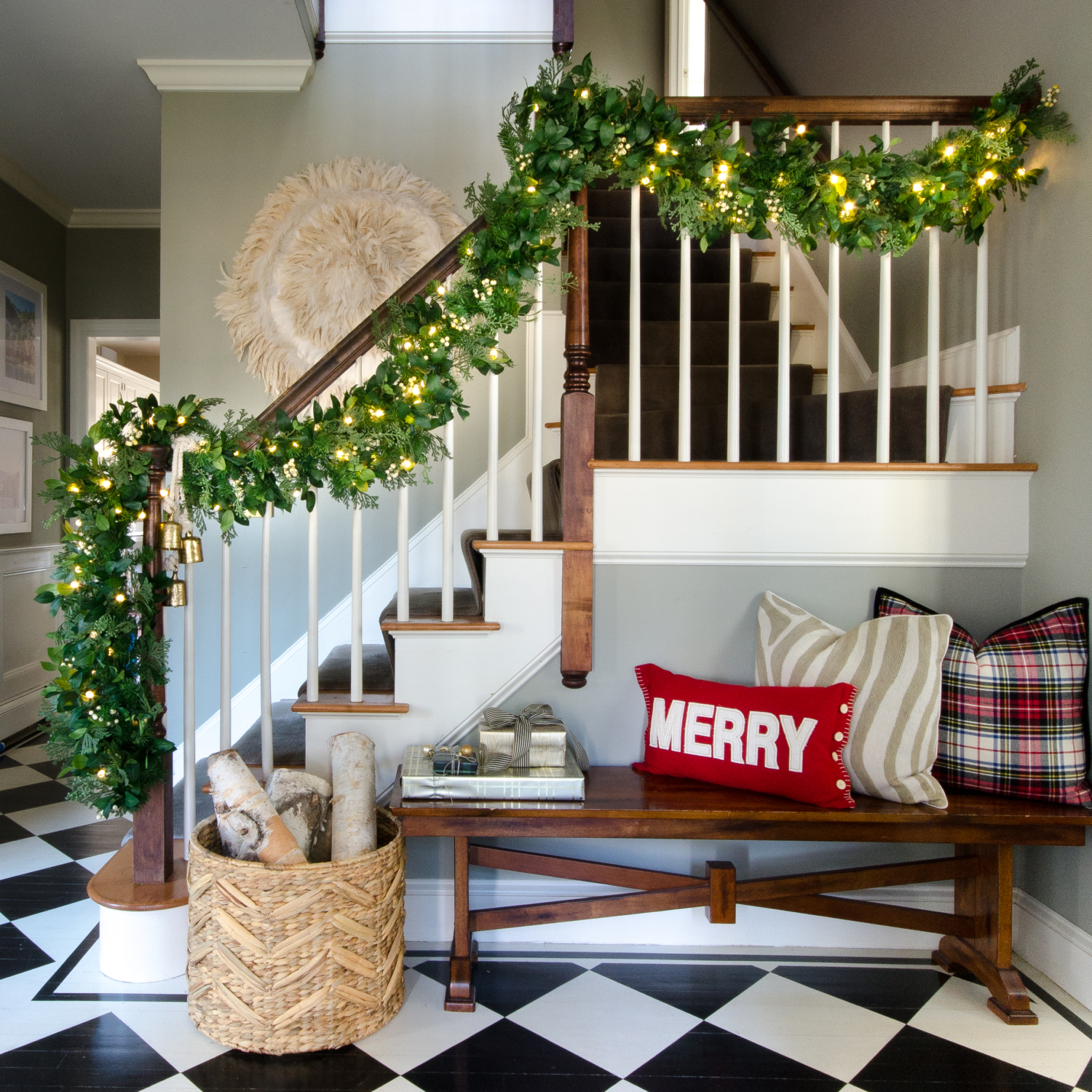 Classic Christmas entry with red, black, white, and greenery
