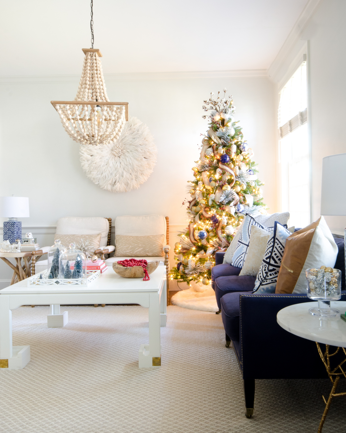 Magical Christmas living room with whites, neutrals, and blues.