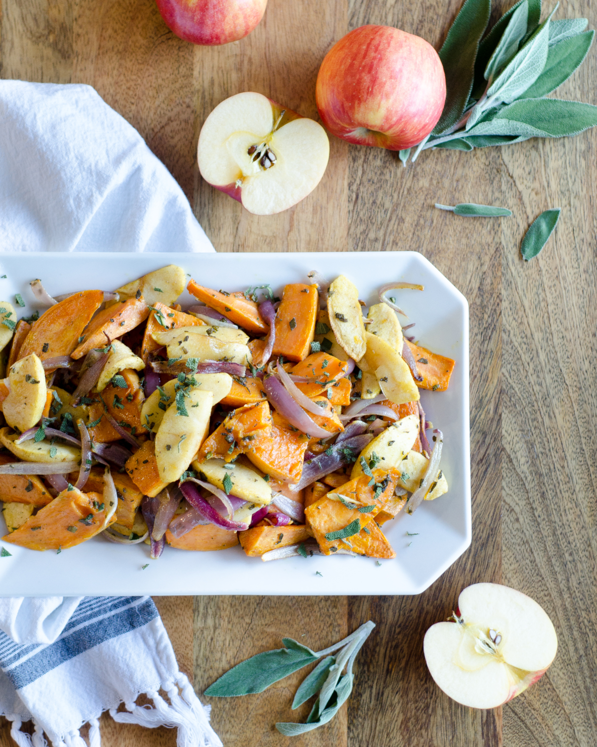 Recipe for roasted sweet potatoes and apples. An easy and delicious fall or winter side dish. Would be an excellent easy Thanksgiving side dish too!