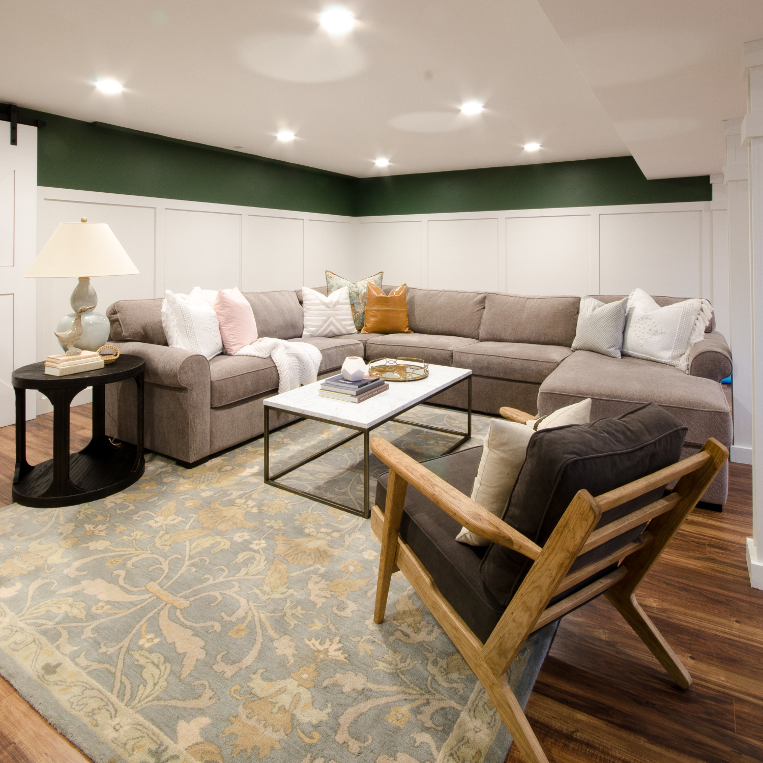 Finished basement family room and playroom with full renovation details. Chic, comfortable, and family-friendly!