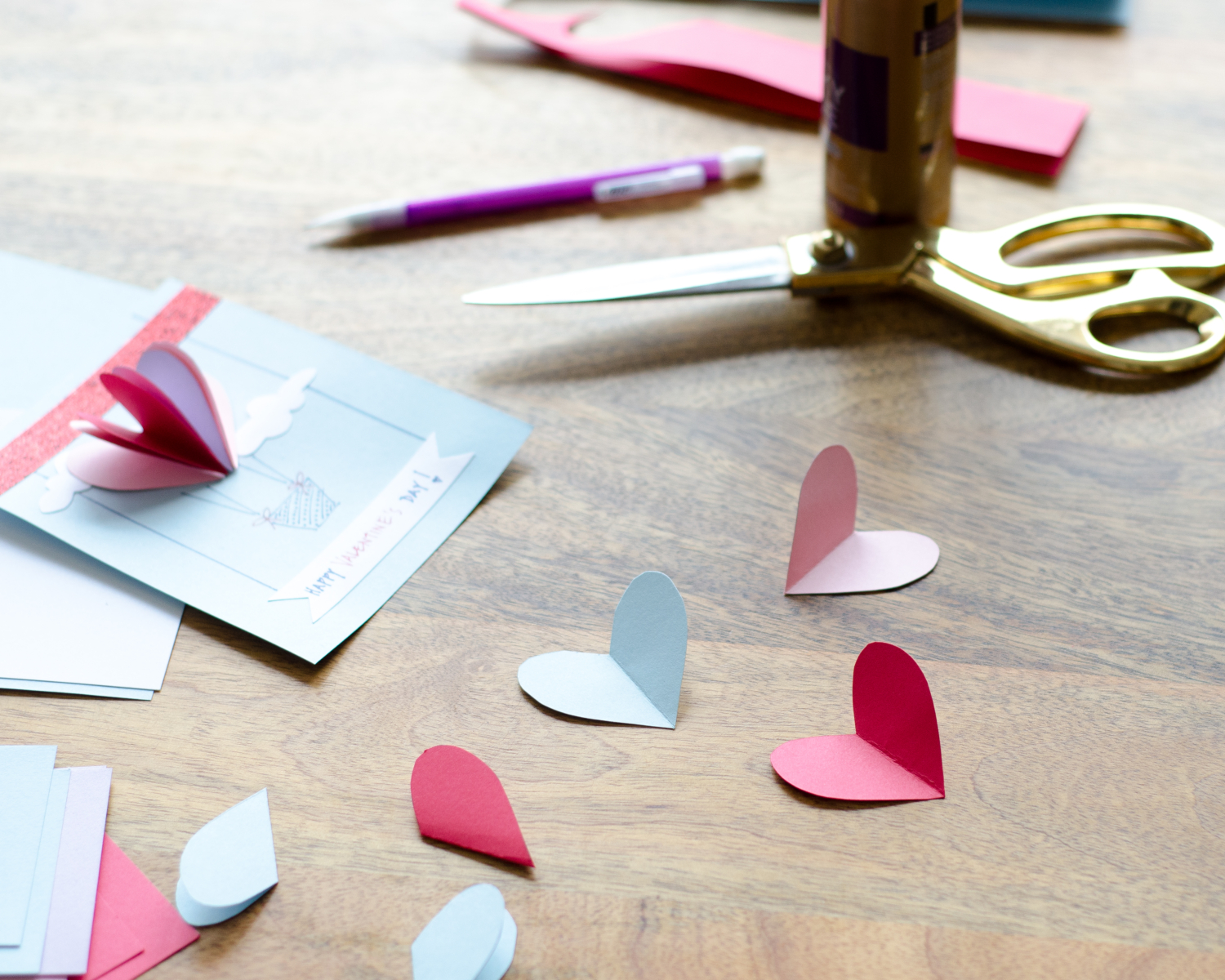 Easy DIY Valentines with 3D paper hearts. Great Valentine's craft for kids that can also be used for exchanging cards at school!