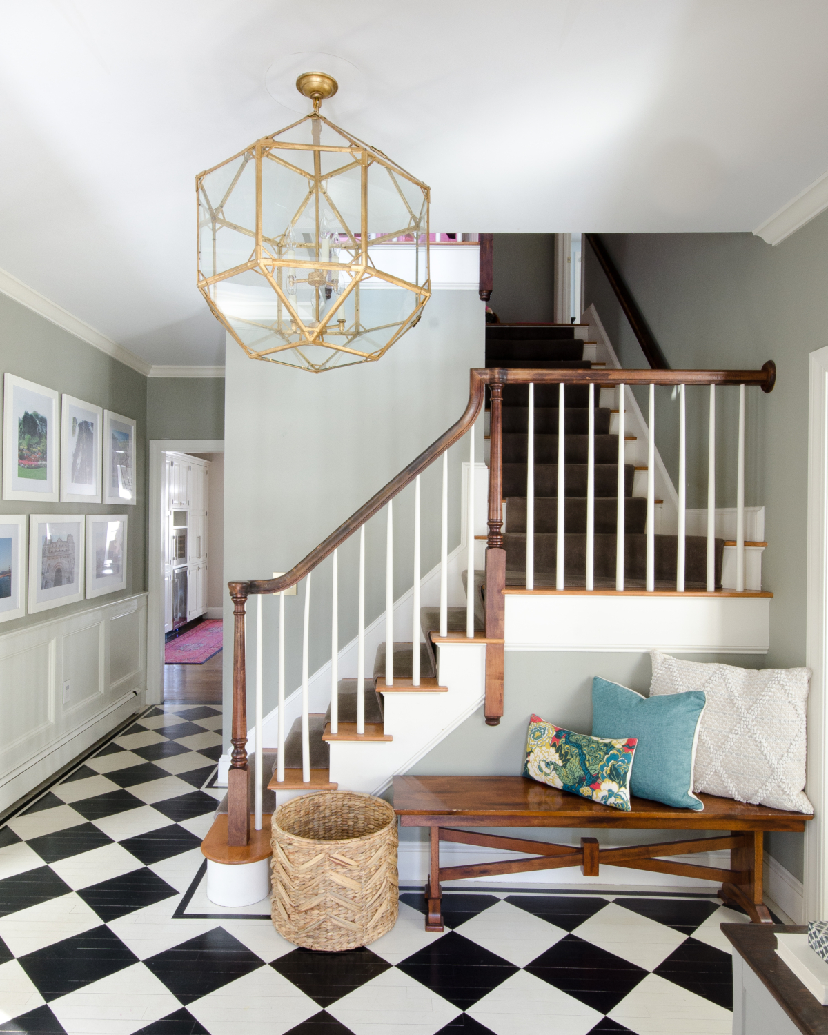 A stunning gold entryway light that is a dread ringer for the Circa Lighting Morris Lantern but at about a third of the price! Checkered floors and simple accents complete the updated classic look of this entry.
