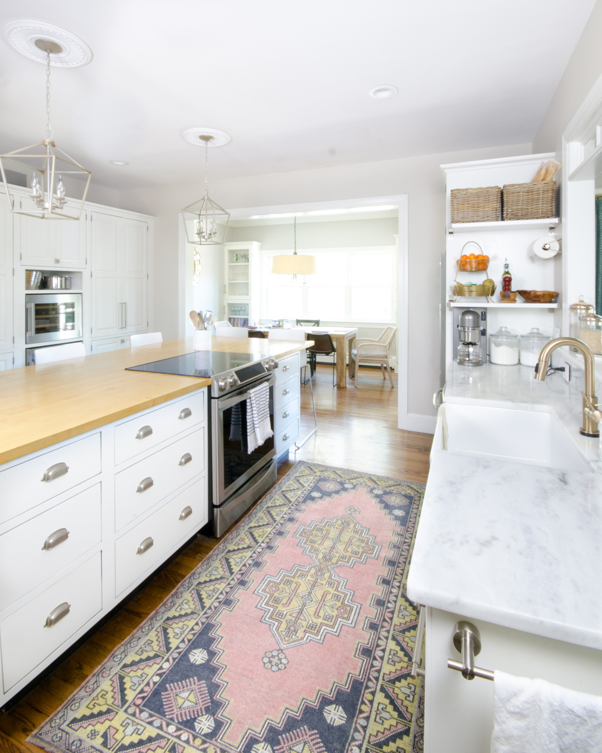 Blush vintage rug in a classic white kitchen, plus sources for similar vintage Turkish rugs in a variety of sizes, all affordably priced!