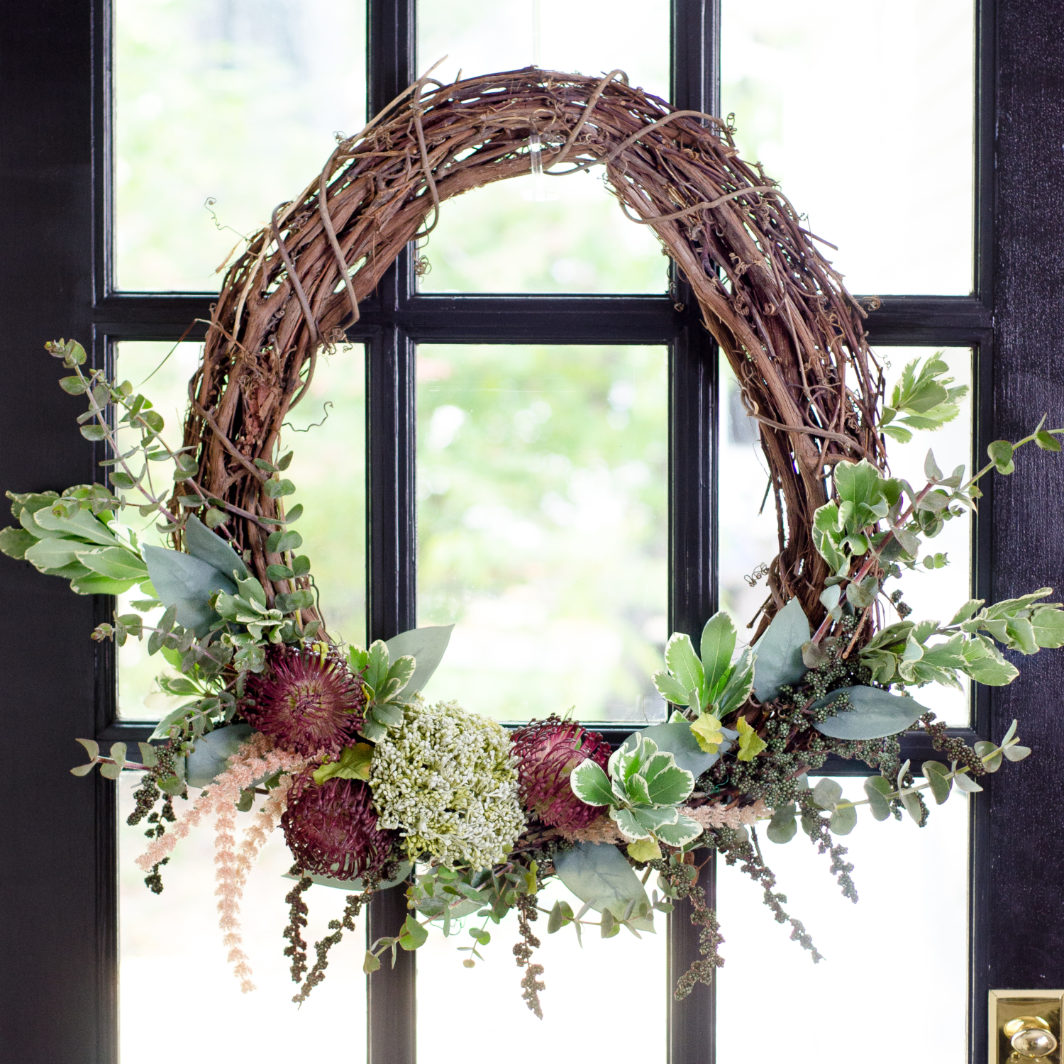 Easy, step-by-step instructions for making a DIY fall wreath with a grapevine base. Budget friendly and done in less than 30 minutes!
