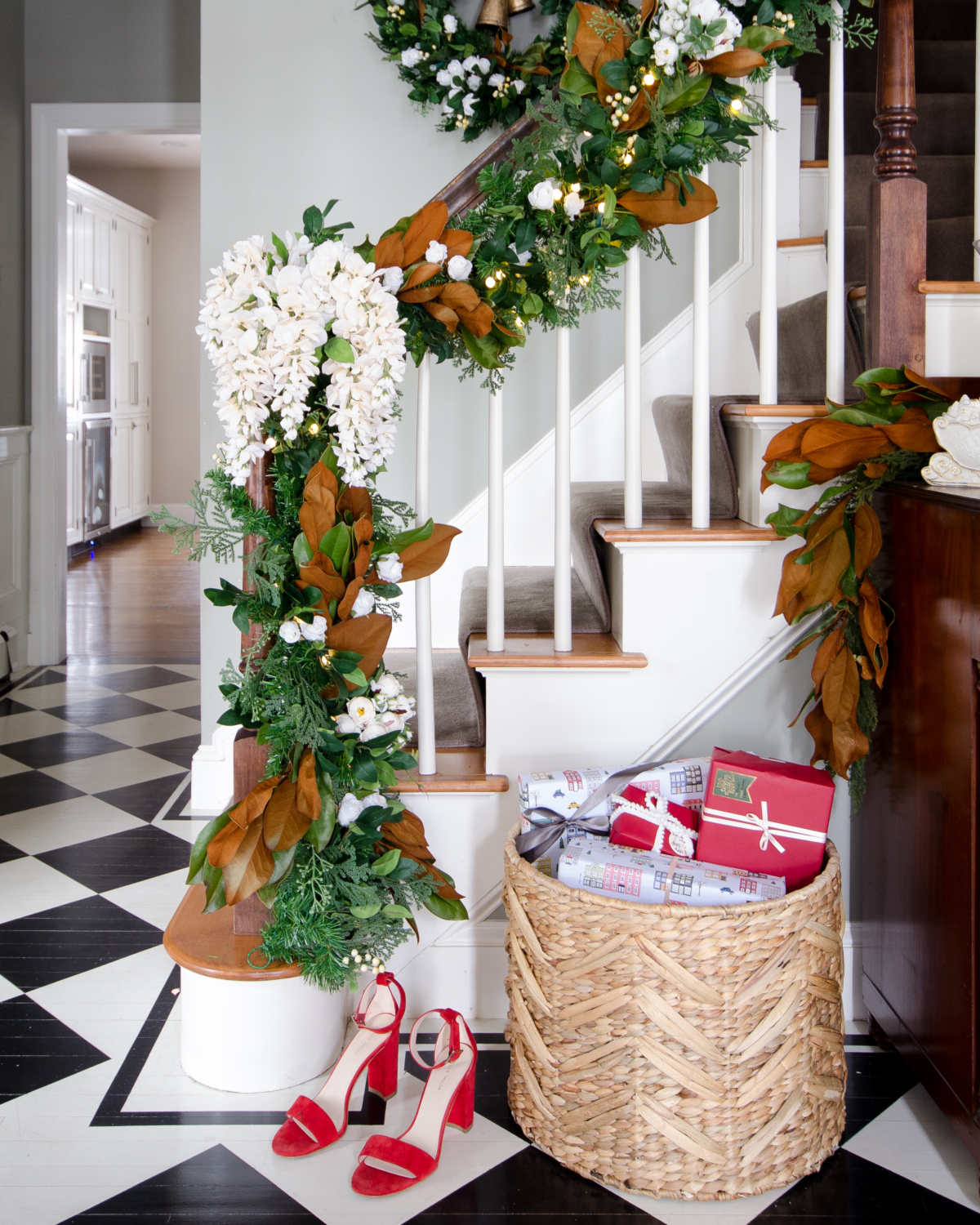 Christmas garland with magnolia and white flowers