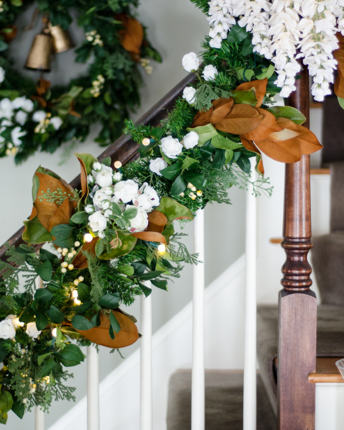 Banister garland with magnolia and white flowers