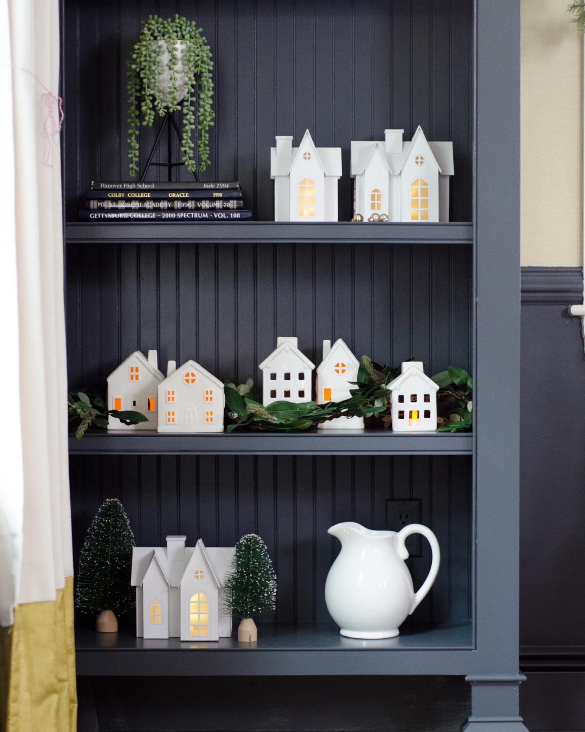 White Christmas houses, Christmas bookshelf styling