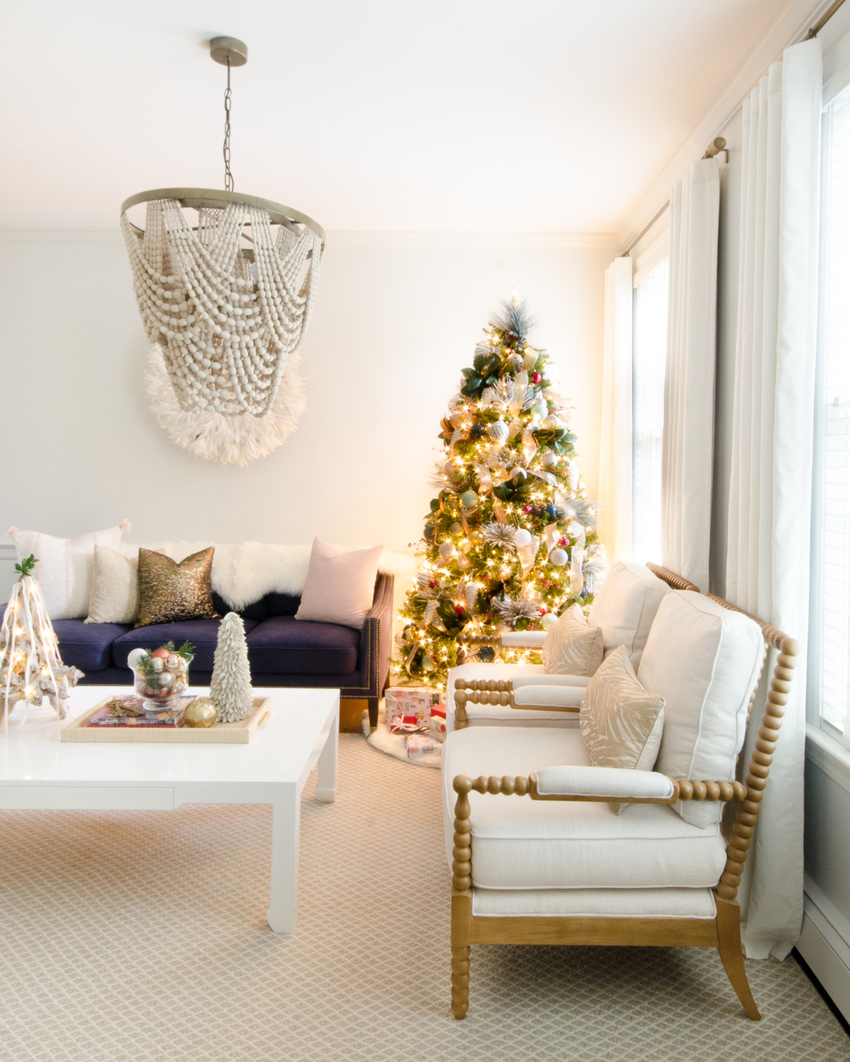 Neutral Christmas living room with white, blush, and cream